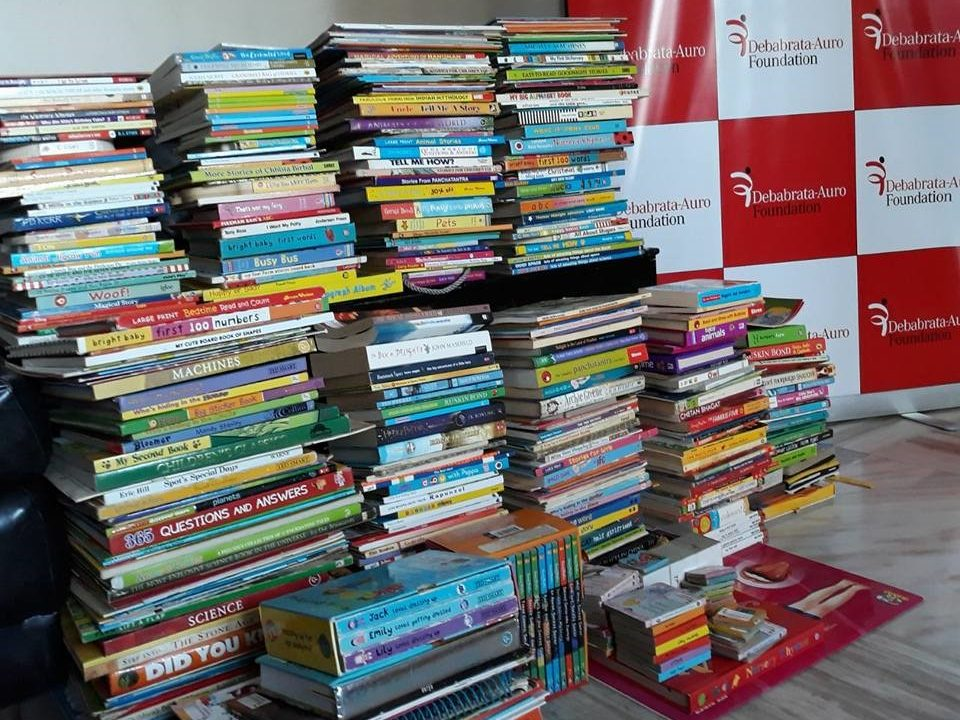 Book Donation to rag-picker's children by DAF- A child who reads will become and adult who thinks.